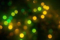 Natural bokeh holiday lights background bright lights green yellow. Natural bokeh holiday lights background for design green yellow royalty free stock photo