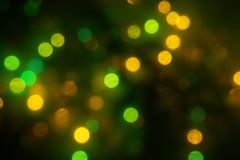 Natural bokeh holiday lights background bright lights green yellow. Natural bokeh holiday lights background for design green yellow royalty free stock images