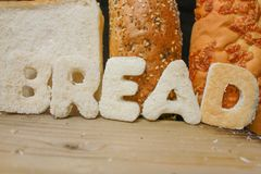 Natural Bread. The word BREAD in sliced white bread stock photography