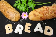 Natural Bread. The word bread with two loaves Stock Image
