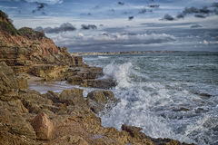 Natural breakwater. Cliff where the sea strength sculpts the landscape and breaks the waves Stock Photo