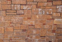 Natural brick stone wall texture background facade surface.  stock photography