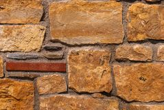 Natural brick stone wall texture background facade surface.  royalty free stock image