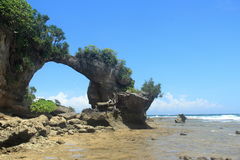 Natural Bridge Arch Formation. Low tide at the natural bridge landmark arch rock formation in a landscape of Neil Island of the Andaman and Nicobar Islands of Royalty Free Stock Images