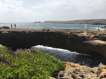 The Natural Bridge in Aruba. Here you see the remains of the natural bridge and the beautiful ocean Stock Photography