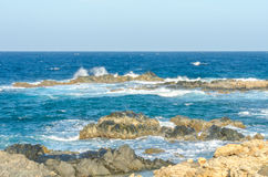 Natural bridge beach at the Caribbean sea in Aruba Royalty Free Stock Images