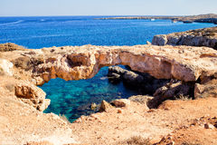 Natural bridge in Cavo Cape Greco, at National Forest Park Royalty Free Stock Photo