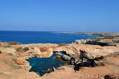 Natural bridge in Cyprus. Natural bridge next to the sea Royalty Free Stock Photos
