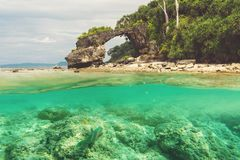 Natural bridge at Neil island, Andaman. And Nicobar. Double photo under water and over water. View of the natural bridge, the main attraction of the island royalty free stock photography