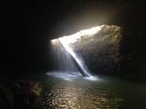 Natural Bridge waterfall in Queensland Stock Photos