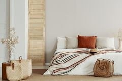 Natural bright bedroom with autumn accents, copy space on white empty wall royalty free stock photography