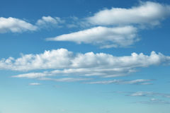 Natural bright blue cloudy sky background Royalty Free Stock Images