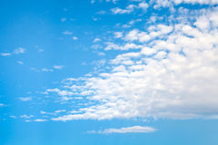 Natural bright blue cloudy sky, background texture Stock Photo