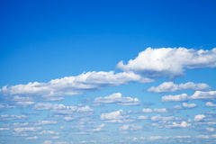 Natural bright blue sky with clouds Stock Photos