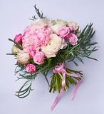 Natural bright bouquet of flowers. Pink flowers on color background. Roses and herbs. bridal bouquet.  Royalty Free Stock Image