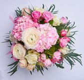 Natural bright bouquet of flowers. Pink flowers on color background. Roses and herbs. bridal bouquet.  Stock Photography