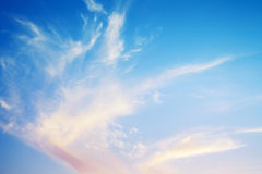 Natural bright cloudy evening sky background texture Stock Images
