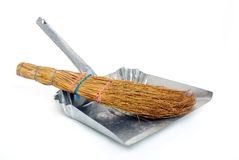 Natural broom in metal dustpan Royalty Free Stock Photography