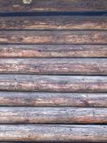 Natural brown barn wood wall. With round horizontal beams Royalty Free Stock Image