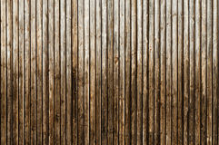 Natural brown barn wood wall. Wooden textured background pattern. Royalty Free Stock Photos