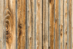 Natural brown barn wood wall. Wooden textured background pattern. Royalty Free Stock Images