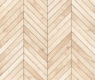 Natural brown wooden parquet herringbone. Wood texture. Royalty Free Stock Image