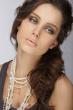 Natural Brunette with Pearly Necklace with Beads Royalty Free Stock Photography