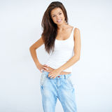 Natural brunette woman in jeans Royalty Free Stock Images