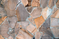 Natural building material, multi-colored sandstone. Wall texture background patterns royalty free stock photography