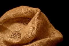 Natural burlap on black background. Closeup Royalty Free Stock Photography