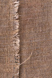 Natural burlap texture with torn edges with space for text Stock Photos
