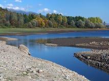 Natural cannal at Liptovska Mara. Autumn view portraying natural canal going trough rocky shore of Liptovska Mara Lake, near Bobrovnik village, Liptov Region royalty free stock photos