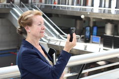 Natural Caucasian businesswoman with mobile phone Stock Photos