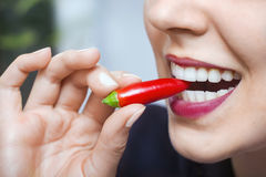 Natural caucasian  woman with red hot chili pepper in mouth Stock Photo