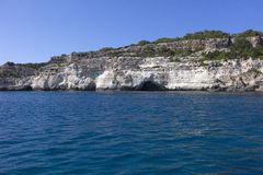 Natural caves on the coast of Menorca, Mediterranean sea, Spain. Royalty Free Stock Photography