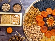 Natural cereal grain food consisted of pistachio, almond, cedar pistachios nuts, buckwheat, pumpkin seeds, flaxseeds, sesame,wheat royalty free stock images