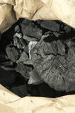 Natural charcoal in paper envelope Stock Image