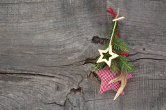 Natural christmas decoration with antler and checked star Stock Photos