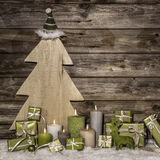 Natural christmas decoration in green and brown on wooden backgr Royalty Free Stock Image