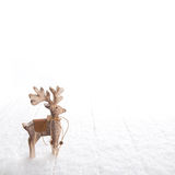 Natural christmas decoration with an isolated deer on white snow Royalty Free Stock Photo