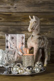 Natural christmas decoration in silver and brown on wooden backg Royalty Free Stock Image