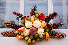 Natural Christmas Decoration. A Christmas Wreath made of pine cones and dried fruit decorates a door at the holidays Stock Photography