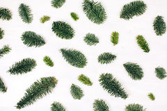 Natural christmas pattern made of fir branches. Winter flat lay style picture. Natural christmas pattern made of fir branches. White wooden rustic background Stock Photos