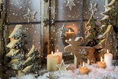 Natural christmas window decoration of wood with snow. Stock Photo