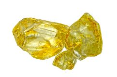 Natural Citrine Gems Stone oval cut beautiful.Holding a yellow topaz stone by tweezers royalty free stock photos