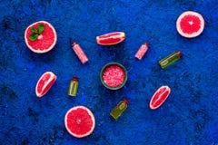 Natural citrus cosmetics. Spa salt near grapefruit on blue background top view. Natural citrus cosmetics. Spa salt near fresh grapefruit on blue background top royalty free stock photo
