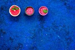 Natural citrus cosmetics. Spa salt near grapefruit on blue background top view mockup. Natural citrus cosmetics. Spa salt near fresh grapefruit on blue stock image