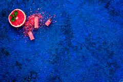 Natural citrus cosmetics. Spa salt near grapefruit on blue background top view mockup. Natural citrus cosmetics. Spa salt near fresh grapefruit on blue royalty free stock photos
