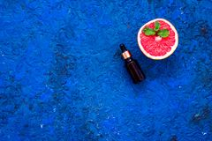 Natural citrus cosmetics. Spa salt near grapefruit on blue background top view mockup. Natural citrus cosmetics. Spa salt near fresh grapefruit on blue royalty free stock photo