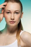 Natural clean portrait of blond woman. Natural clean portrait of blond young woman holding hand near her her face royalty free stock photography